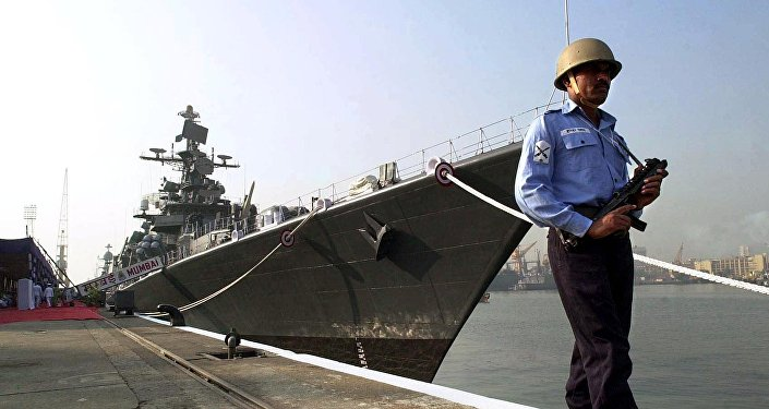 India naval guard keeps watch on the two guided missile warships 'Mumbai' and 'Kirch' constructed at the Mazagon Docks in Bombay (file)