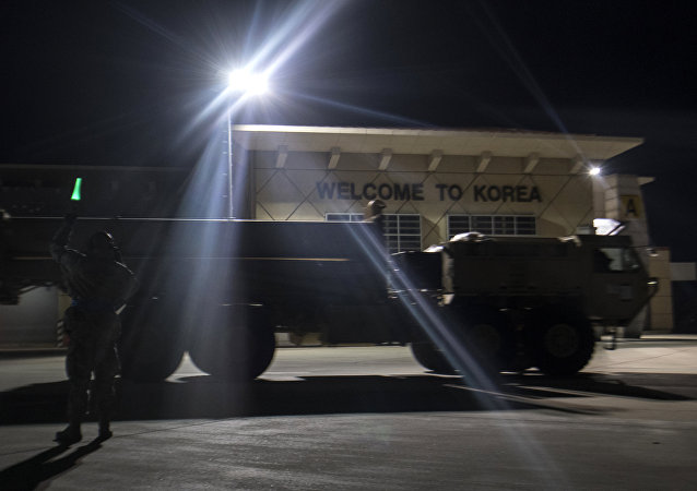 In this photo provided by U.S. Forces Korea, a truck carrying parts of U.S. missile launchers and other equipment needed to set up the Terminal High Altitude Area Defense (THAAD) missile defense system arrive at Osan air base in Pyeongtaek, South Korea, Monday, March 6, 2017.