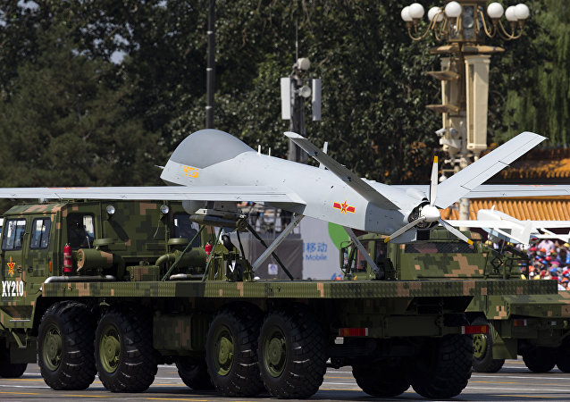 A military vehicle carrying a Wing Loong, a Chinese made medium altitude long endurance unmanned aerial vehicle, drives past during a military parade at Tiananmen Square in Beijing (File)