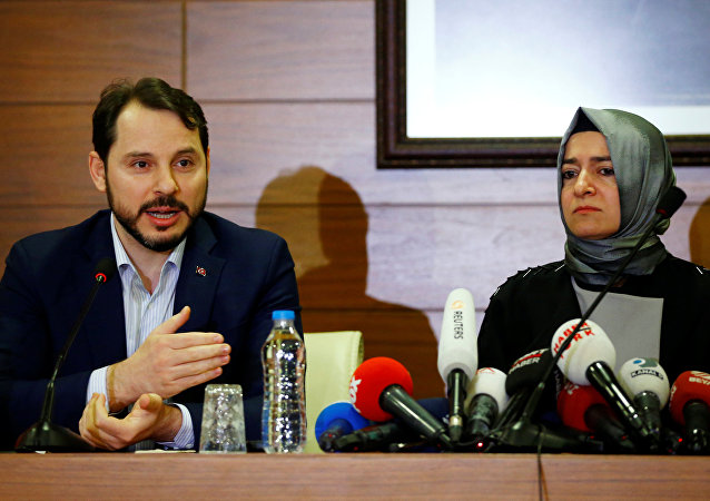 Turkey's Energy Minister Berat Albayrak, accompanied by Family and Social Affairs Minister Fatma Betul Sayan Kaya, speaks during a news conference at Ataturk International airport in Istanbul, Turkey