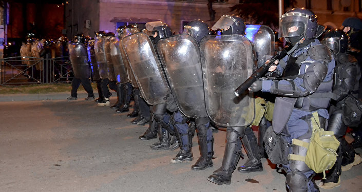 Riot police make a line during riots in the Georgian Black Sea port of Batumi, early Sunday, March 12, 2017.