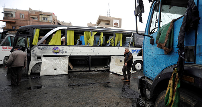People inspect the damage at the site of an attack by two suicide bombers in Damascus, Syria