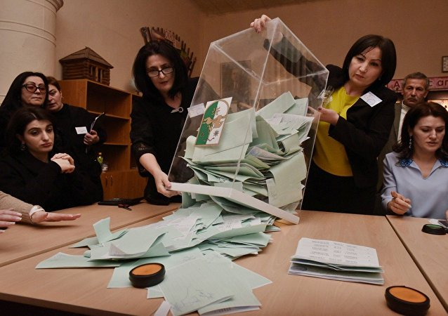 Counting ballots at a polling station in Sukhum during parliamentary election