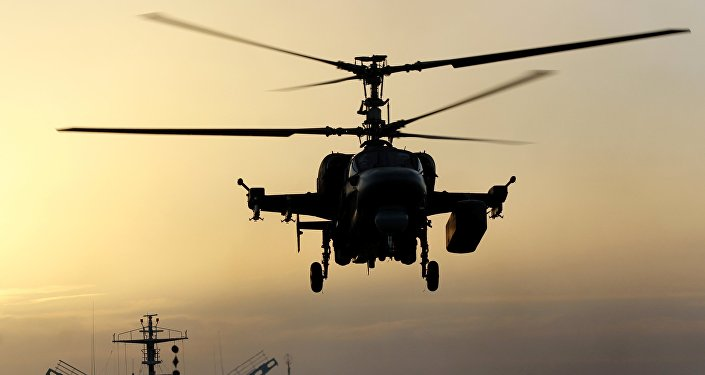 Ka-52K helicopter takes off from the deck of Admiral Kuznetsov heavy aircraft carrier in the Mediterranean Sea