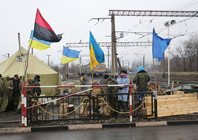 Ukrainian nationalist protesters and military veterans take part in a blockade against ongoing trade with Russian-backed insurgents, on February 23, 2017, in Kryvyi Torets railway station, Donetsk region