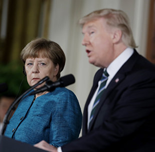 German Chancellor Angela Merkel listens as President Donald Trump speaks during their joint news conference in the East Room of the White House in Washington, Friday, March 17, 2017