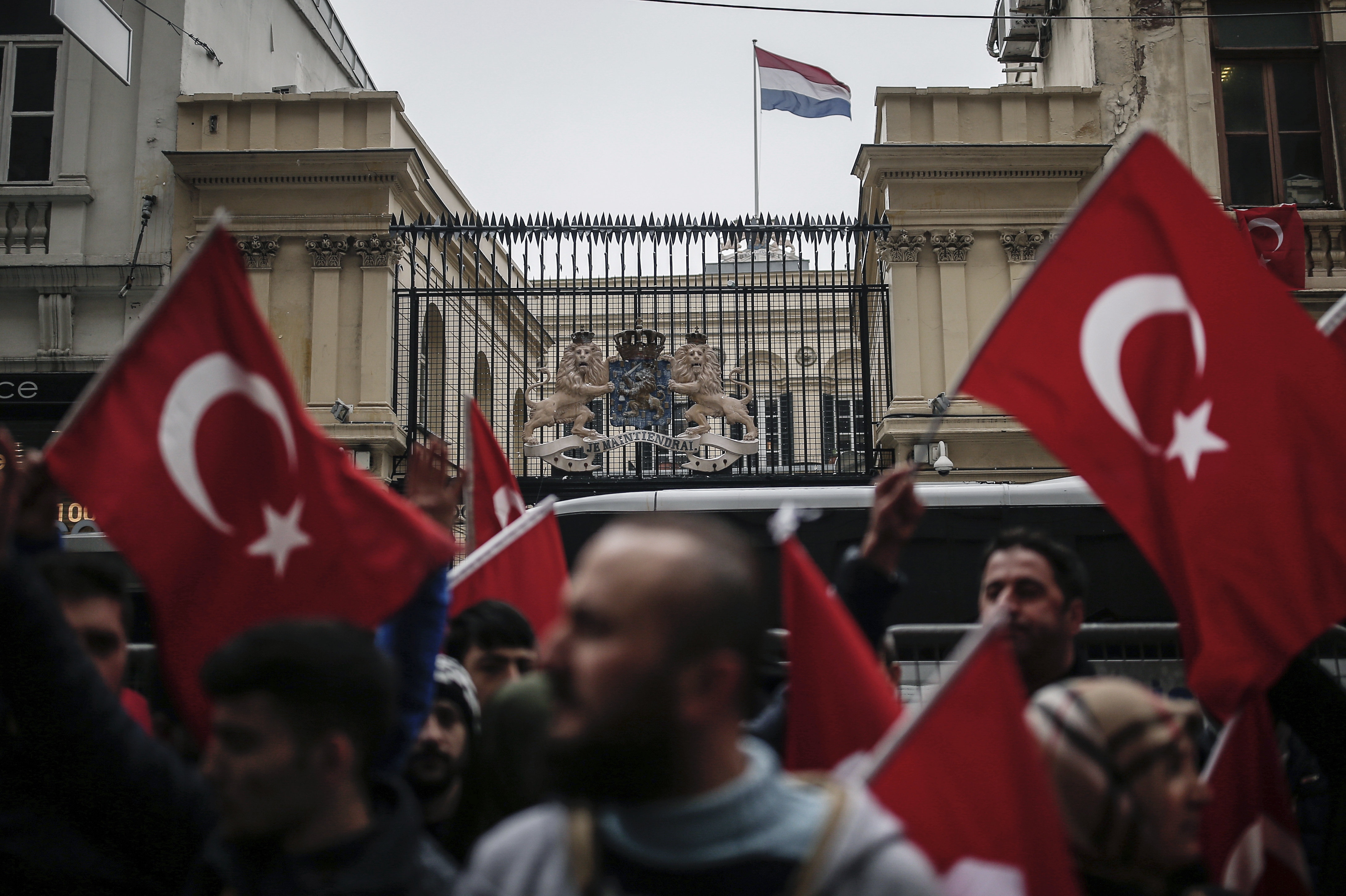 A group of Turks protest outside the Dutch consulate in Istanbul, Sunday, March 12, 2017
