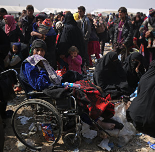 Iraqi families displaced from the city of Mosul arrive at a camp in the Hamam al-Alil area south of the embattled city on March 11, 2017, during the ongoing government forces offensive to retake the area from Islamic State (IS) group fighters