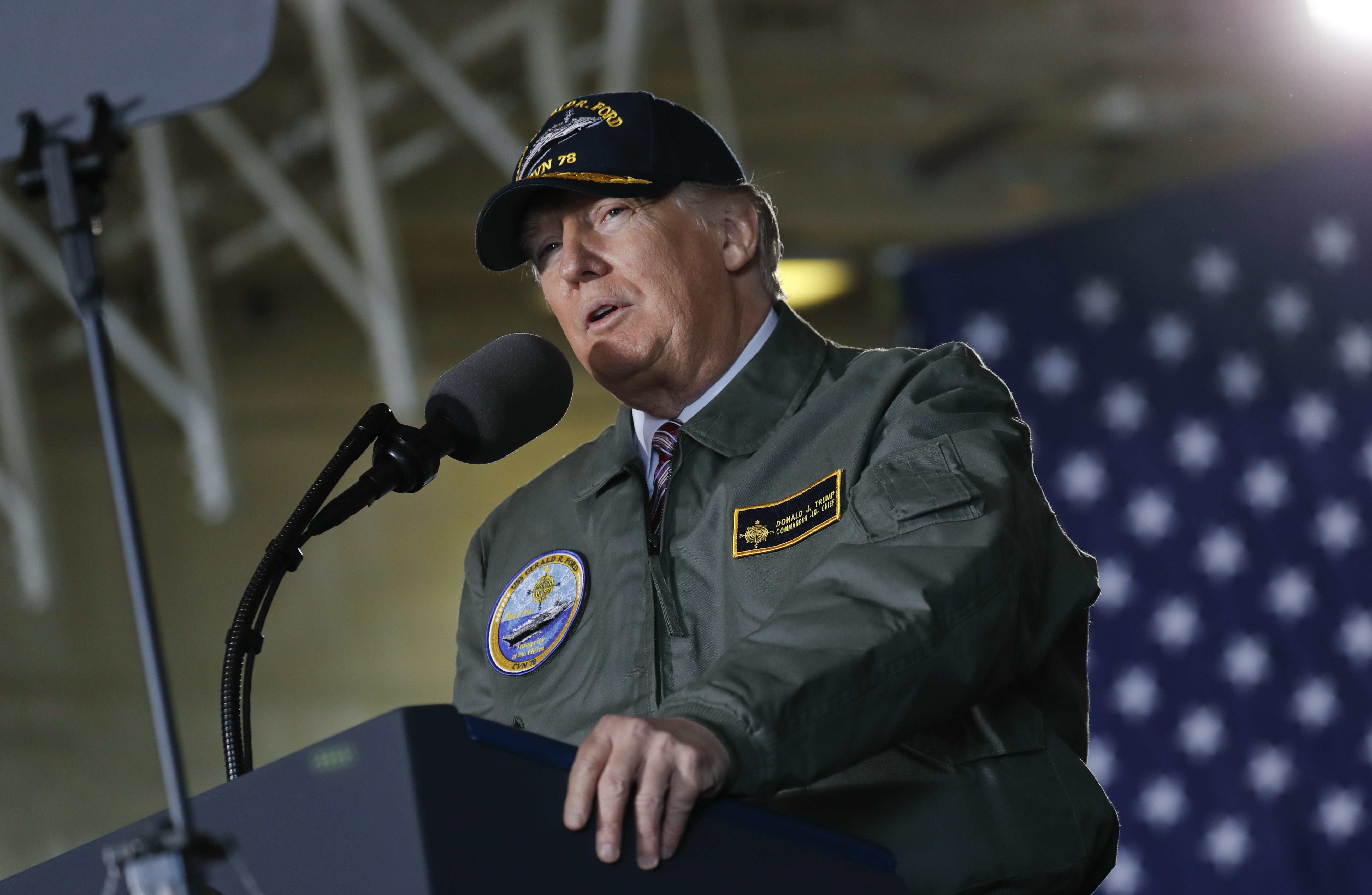President Donald Trump reads from a teleprompter during a speech aboard the nuclear aircraft carrier Gerald R. Ford, at Newport News Shipbuilding in Newport News, Va., Thursday, March 2, 2017.