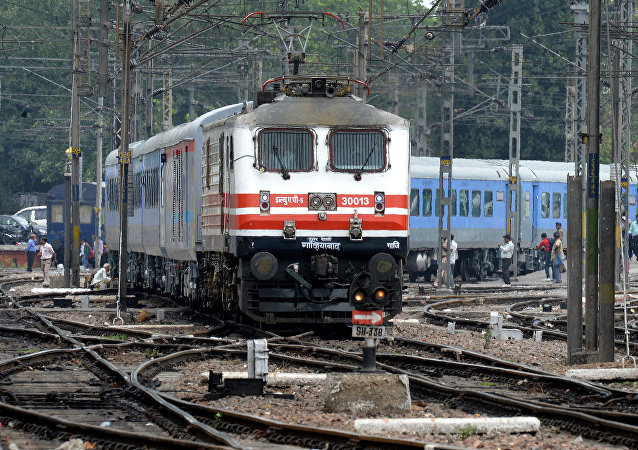 The passenger train sets off during the trial run of a 'semi-bullet train' between New Delhi and Agra from New Delhi railway station in New Delhi on July 3, 2014