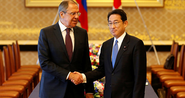 Russian Foreign Minister Sergei Lavrov (L) shakes hands with Japanese Foreign Minister Fumio Kishida at the start of their meeting as a part of Japan-Russia foreign and defence ministers meeting called two-plus-two at Iikura guest house in Tokyo, Japan March 20, 2017.