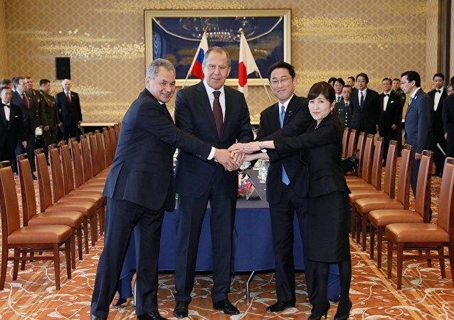 From left: Russian Defense Minister Sergei Shoigu, Russian Foreign Minister Sergei Lavrov, Japanese Foreign Minister Fumio Kishida and Japanese Defense Minister Tomomi Inada during two-plus-two talks between defense and foreign ministers of Japan and Russia, in Tokyo.