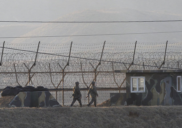 South Korean army soldiers patrol along the barbed-wire fence in Paju, South Korea, near the border with North Korea, Monday, March 6, 2017.