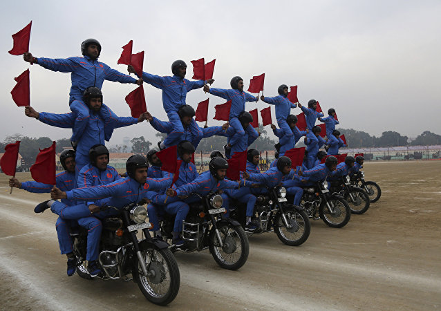 Indian policemen perform acrobatic skills on a motorcycle during rehearsals for the Republic Day parade in Jammu, India, Tuesday, Jan. 24, 2017.