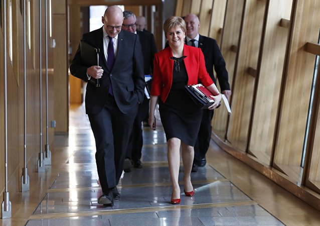 Scotland's First Minister Nicola Sturgeon and Deputy First Minister John Swinney arrive at the Scottish Parliament ahead of a referendum debate in Edinburgh Scotland , Scotland, Britain March 21, 2017.