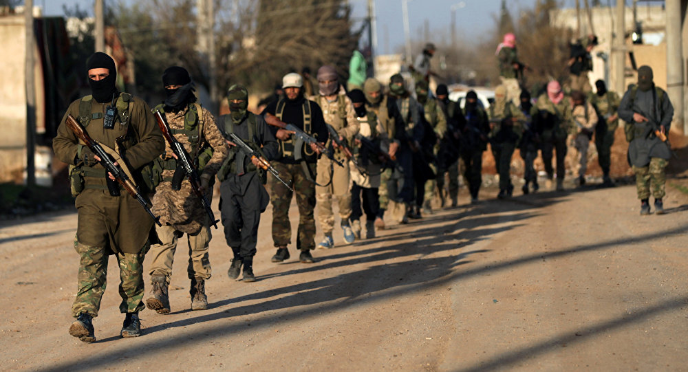 Fighters from the Ahrar al-Sharqiya rebel group walk with their weapons during a training near the northern Syrian town of al-Rai, Syria March 20, 2017