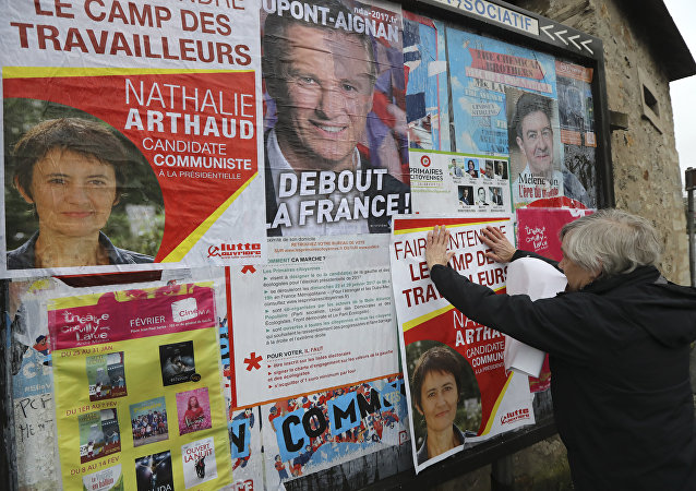 A French far-left Lutte Ouvriere (LO) party's member puts up posters of French presidential election candidate for LO party Nathalie Arthaud on February 5, 2017 in Chevilly-Larue, southern Paris