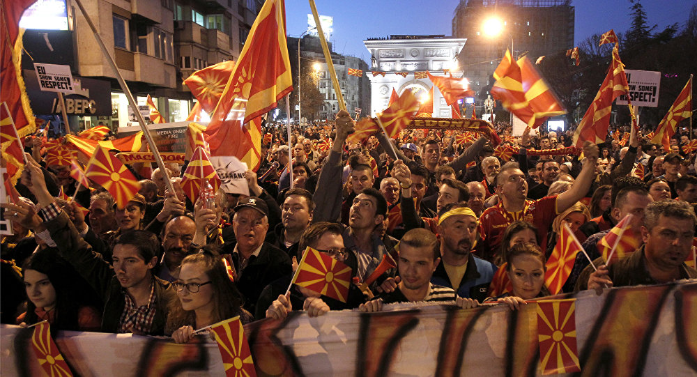 People protest in front of the Parliament building in Skopje, Macedonia, on Tuesday, March 21, 2017. Tens of thousands of demonstrators gathered in Macedonia's capital, Skopje, Tuesday to protest a visit by a European Union envoy who is trying to break the political deadlock that has left the country without a government for three months
