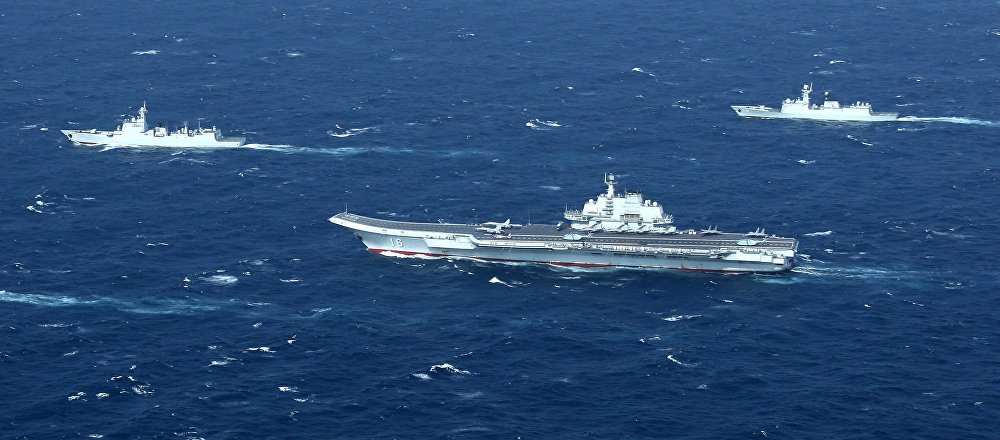 China's Liaoning aircraft carrier with accompanying fleet conducts a drill in an area of South China Sea in this undated photo taken December, 2016