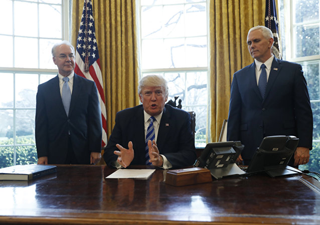 President Donald Trump, flanked by Health and Human Services Secretary Tom Price, left, and Vice President Mike Pence, meets with members of the media regarding the health care overhaul bill, Friday, March 24, 2017, in the Oval Office of the White House in Washington.