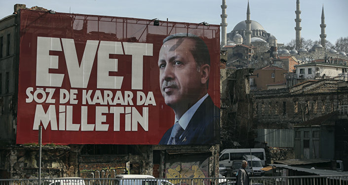 A poster of Turkey's President Recep Tayyip Erdogan for the upcoming referendum is seen backdropped by the Suleymaniye Mosque in Istanbul, Friday, March 24, 2017