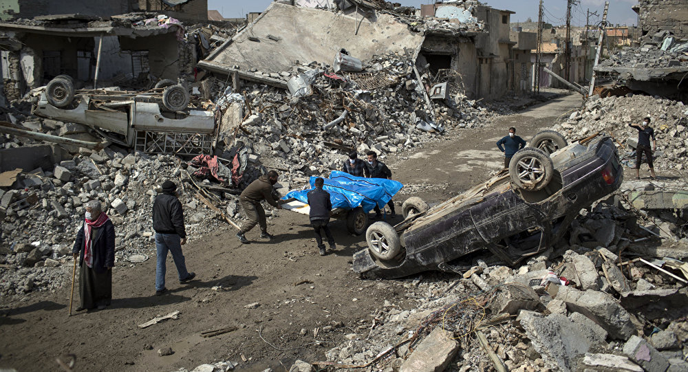 Residents carry the body of several people killed during fights between Iraq security forces and Islamic State on the western side of Mosul, Iraq, Friday, March 24, 2017
