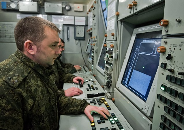 Officers of an air defense regiment of the Russian Armed Forces during a combat alert duty at the control board of an S-400 Triumf missile system in Crimea.