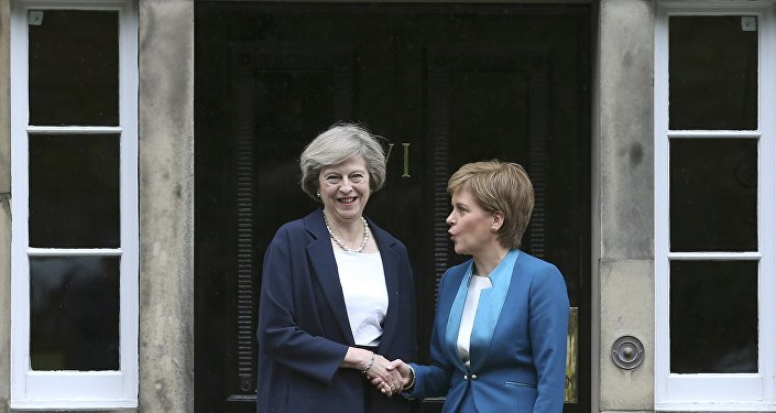 Scotland's First Minister Nicola Sturgeon greets Britain's new Prime Minister Theresa May as she arrives at Bute House in Edinburgh, July 15, 2016.