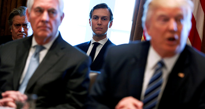 White House advisors Jared Kushner and Steve Bannon look on as US President Donald Trump (R), flanked by Secretary of State Rex Tillerson (2nd L), holds a cabinet meeting at the White House in Washington, US