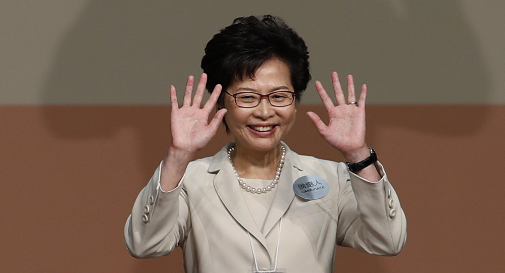 Former Hong Kong Chief Secretary Carrie Lam waves as she declares her victory in the chief executive election of Hong Kong in Hong Kong