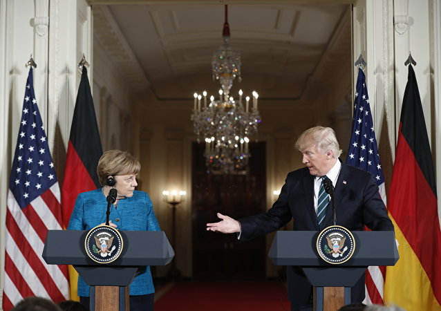 President Donald Trump and German Chancellor Angela Merkel participate in a joint news conference in the East Room of the White House in Washington