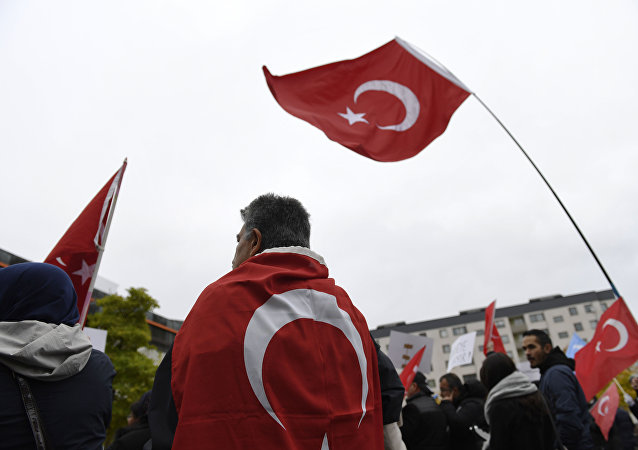 Protesters with Turkish flags gather outside the Bredangsskolan school in southern Stockholm, Sweden (file)