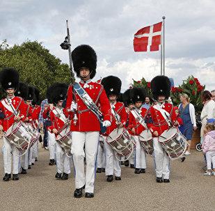The Tivoli Boys Guard play for Copenhagen's landmark Little Mermaid at Langelinie in Copenhagen