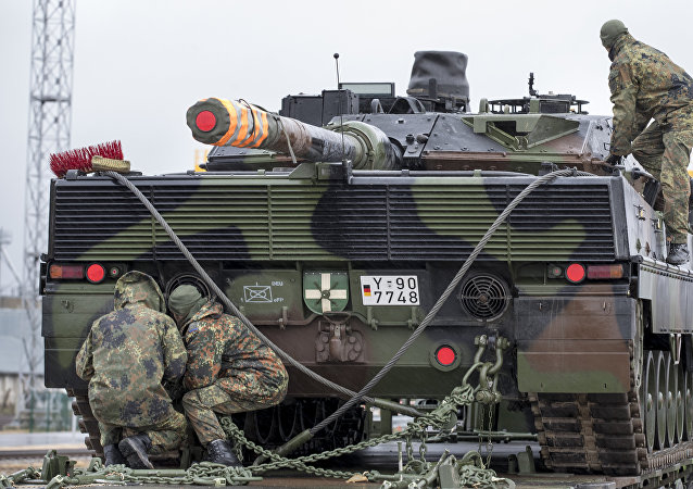 German army soldiers load a Leopard 2 tank onto a truck at the Sestokai railway station some 175 kms (109 miles) west of the capital Vilnius, Lithuania, Friday, Feb. 24, 2017.