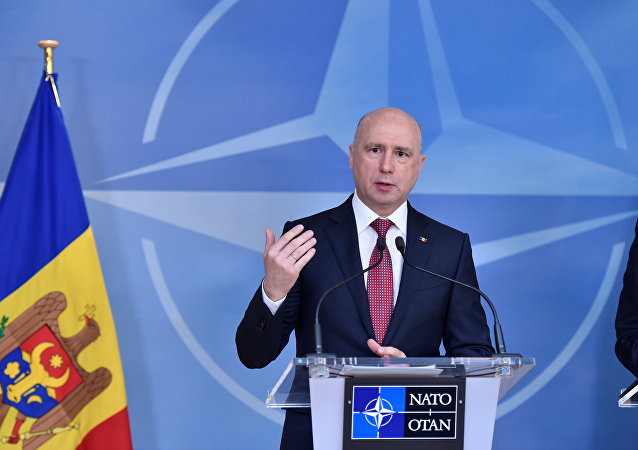 Moldova's Prime Minister Pavel Filip gives a joint statement with NATO Secretary General Jens Stoltenberg after a meeting at NATO Headquarters in Brussels, Belgium March 30, 2017.