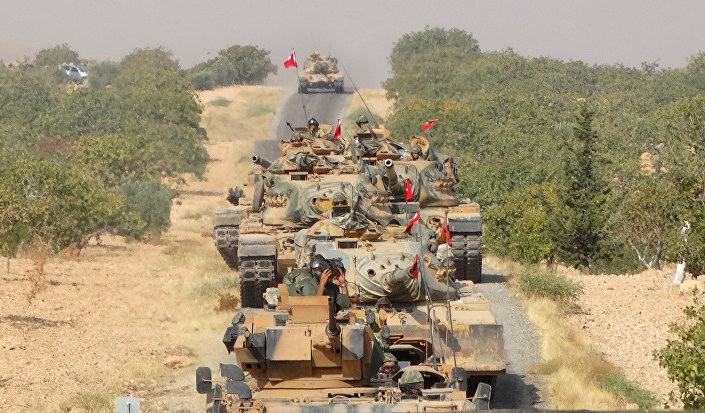 Turkish army tanks make their way towards the Syrian border town of Jarabulus, Syria August 24, 2016