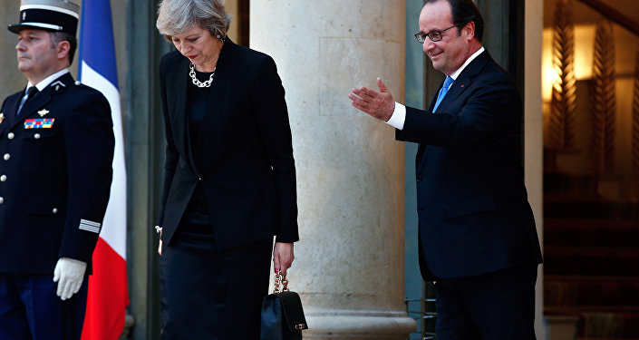 France's President Francois Hollande gestures as Britain's Prime Minister Theresa May leaves the Elysee Palace, in Paris, Thursday, July 21, 2016.