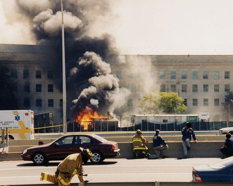 9/11, 2001. Thick plumes of smoke choke the sky above the burning Pentagon.