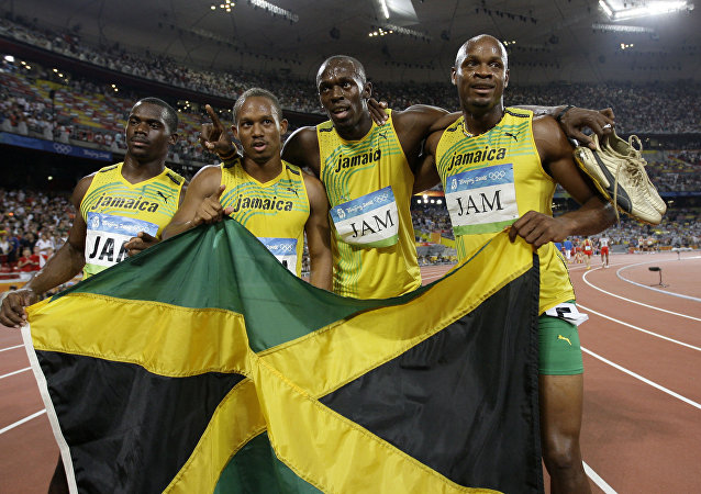 Jamaica's gold medal winning relay team, Usain Bolt, 2nd right, Michael Frater, 2nd left, Asafa Powell, right, and Nesta Carter celebrate after the men's 4x100-meter relay final during the athletics competitions in the National Stadium at the Beijing 2008 Olympics in Beijing, Friday, Aug. 22, 2008