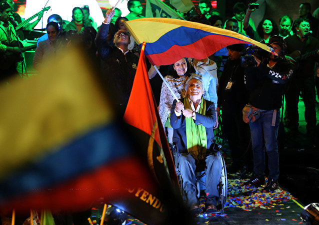 Lenin Moreno (C) wait with supporters for the results of the national election in a hotel, in Quito, April 2, 2017