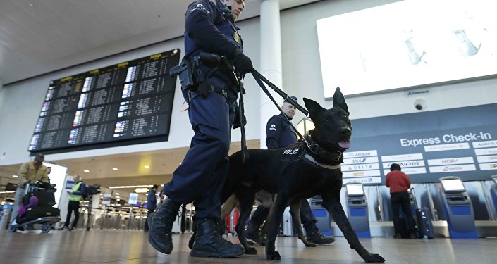 Policemen patrol in the Zaventem airport prior to a ceremony commemorating the first anniversary of twin attacks at Brussels airport and a metro train in Brussels, Belgium, March 22, 2017.