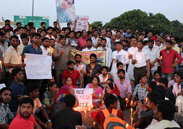 This photo taken on March 27, 2017 shows people gathering for a vigil for a teenage boy who died of a suspected drug overdose in Greater Noida, which later turned into a violent rampage against African nationals
