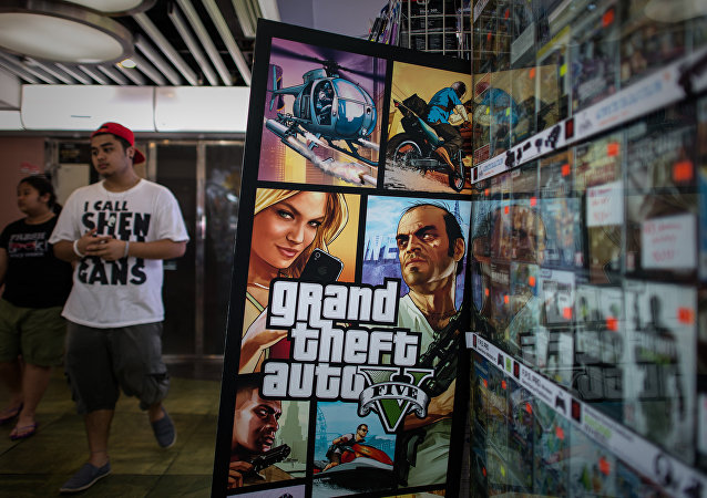 A man walks past a billboard of the Grand Theft Auto V video game in Hong Kong on September 17, 2013