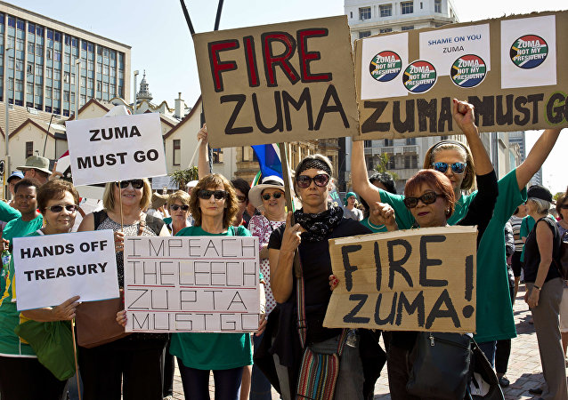 Protestors hold up placards reading 'Fire Zuma' during a demonstration of supporters of the Save South Africa (SaveSA) campaign, civil society organisations and political parties demanding South African President Jacob Zuma to resign on April 4, 2017 in Port Elizabeth, South Africa