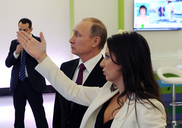 Vladimir Putin visits exhibition marking Russia Today news channel's 10th anniversary