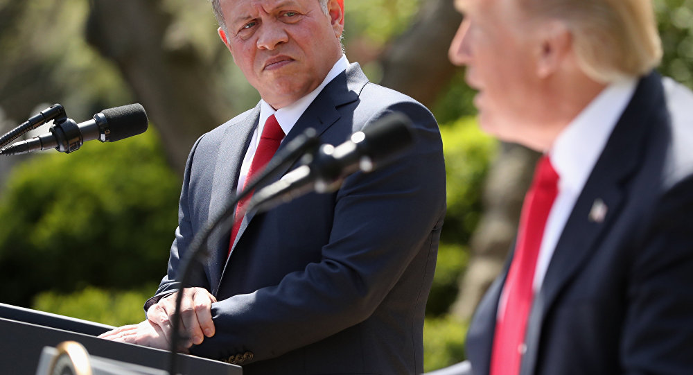 Jordan's King Abdullah II listens as President Donald Trump speaks during their news conference in the Rose Garden at the White House in Washington, Wednesday, April 5, 2017