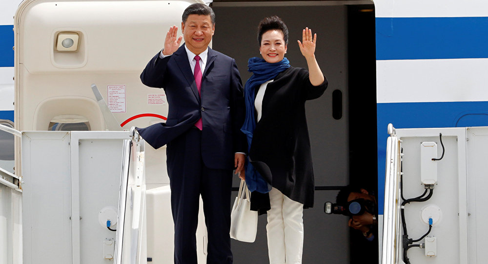 China's President Xi Jinping and his wife Peng Liyuan arrive at Palm Beach International Airport in West Palm Beach, Florida, U.S