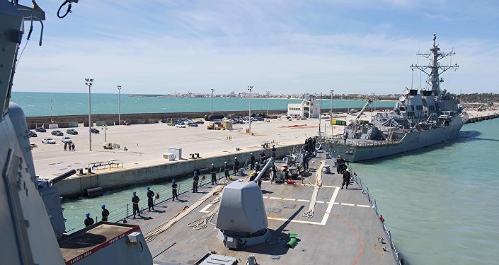 In this photo provided by the U.S. Navy, the Arleigh Burke-class guided-missile destroyer USS Ross (DDG 71) departs Rota, Spain, on March 29, 2017.