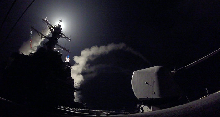 In this image provided by the US Navy, the guided-missile destroyer USS Porter (DDG 78) launches a tomahawk land attack missile in the Mediterranean Sea, Friday, April 7, 2017.