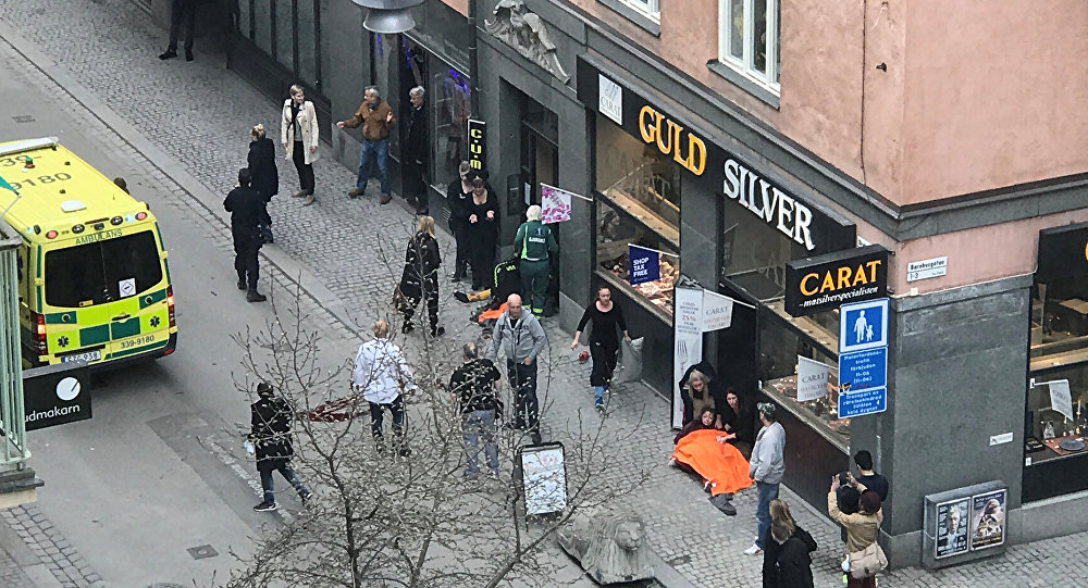 At least 3 dead, 1 arrested after truck drives into Stockholm crowd